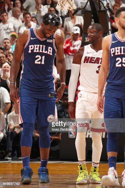 Joel Embiid of the Philadelphia 76ers and Dwyane Wade of the Miami Heat in Game Four of the Eastern Conference Quarterfinals during the 2018 NBA...