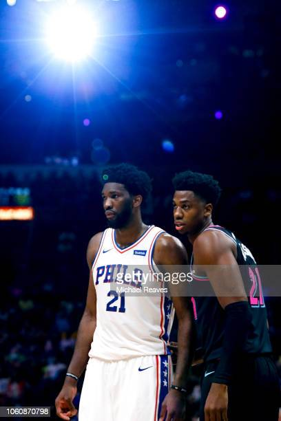 Joel Embiid of the Philadelphia 76ers and Hassan Whiteside of the Miami Heat looks on during the second half at American Airlines Arena on November...