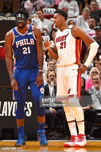Joel Embiid of the Philadelphia 76ers and Hassan Whiteside of the Miami Heat talk during the game in Game Three of Round One of the 2018 NBA Playoffs...