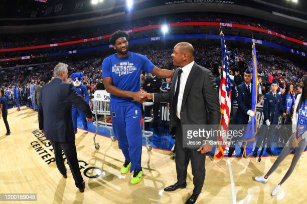 Joel Embiid of the Philadelphia 76ers and Head Coach Doc Rivers of the LA Clippers talk prior to a game on February 11, 2020 at the Wells Fargo...