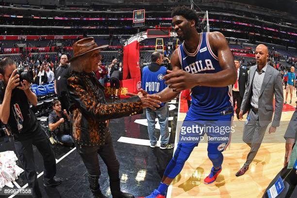 Joel Embiid of the Philadelphia 76ers and James Goldstein shake hands after the game against the LA Clippers on November 13 2017 at STAPLES Center in...
