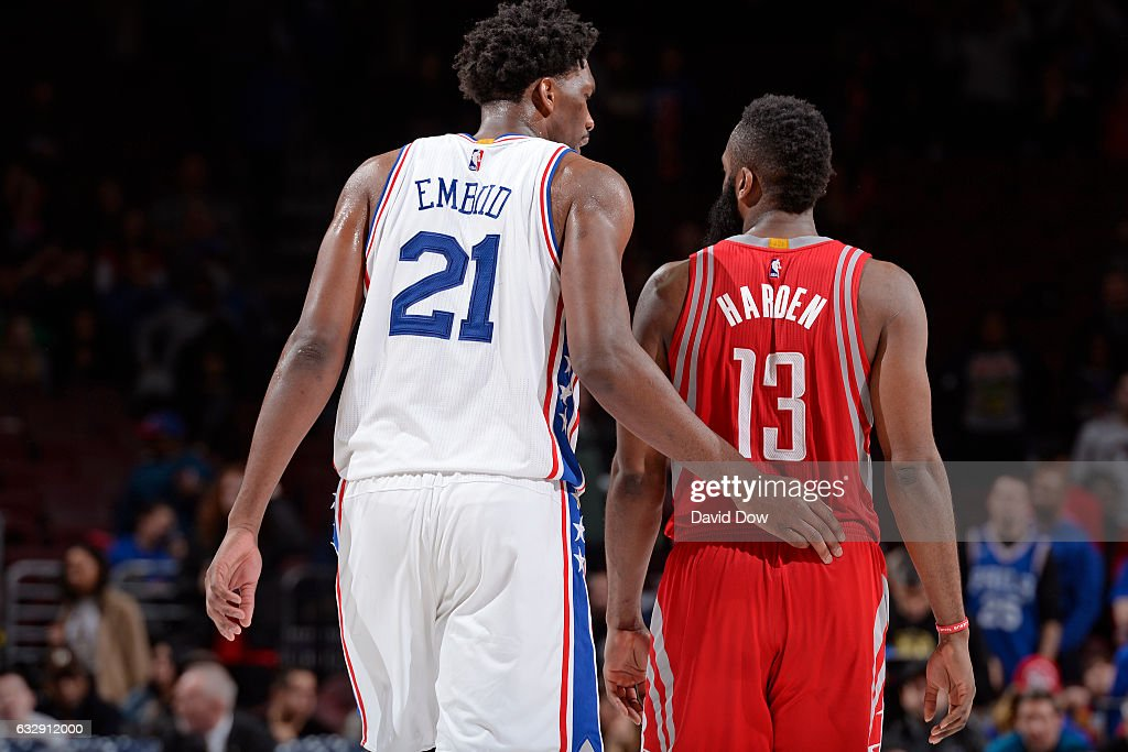 Joel Embiid #21 of the Philadelphia 76ers and James Harden #13 of the Houston Rockets have a conversation during the game at Wells Fargo Center on January 27, 2017 in Philadelphia, Pennsylvania
