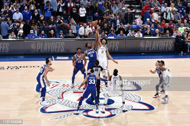 Joel Embiid of the Philadelphia 76ers and Jarrett Allen of the Brooklyn Nets jump for the opening tipoff in Game Two of Round One during the 2019 NBA...