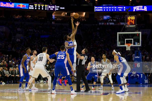Joel Embiid of the Philadelphia 76ers and Jarrett Allen of the Brooklyn Nets compete for the opening tipoff in Game Two of Round One of the 2019 NBA...