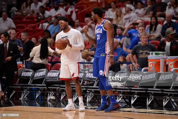 Joel Embiid of the Philadelphia 76ers and Justise Winslow of the Miami Heat speak before the game between the two teams in Game Three of Round One of...