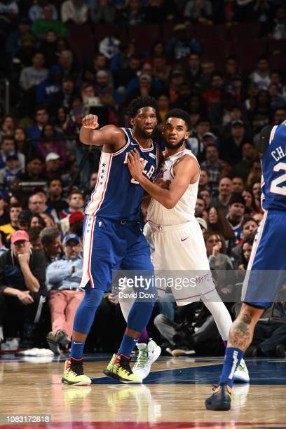 Joel Embiid of the Philadelphia 76ers and KarlAnthony Towns of the Minnesota Timberwolves fight for position on January 15 2019 at the Wells Fargo...