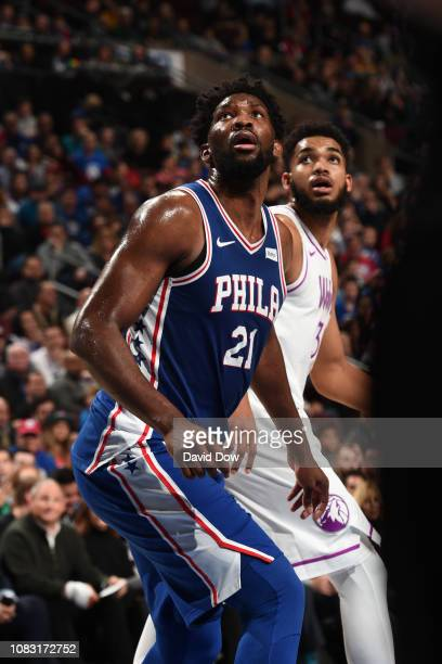 Joel Embiid of the Philadelphia 76ers and KarlAnthony Towns of the Minnesota Timberwolves look to rebound on January 15 2019 at the Wells Fargo...