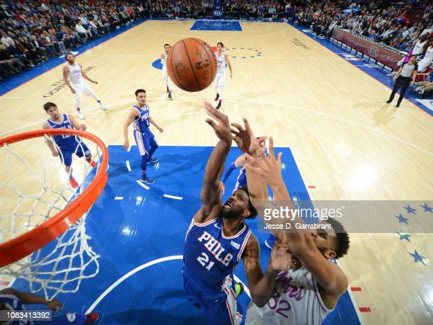 Joel Embiid of the Philadelphia 76ers and KarlAnthony Towns of the Minnesota Timberwolves battle for the rebound during the game on January 15 2019...