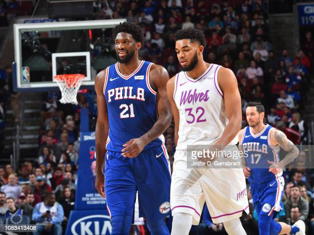 Joel Embiid of the Philadelphia 76ers and KarlAnthony Towns of the Minnesota Timberwolves move up the court during the game on January 15 2019 at the...
