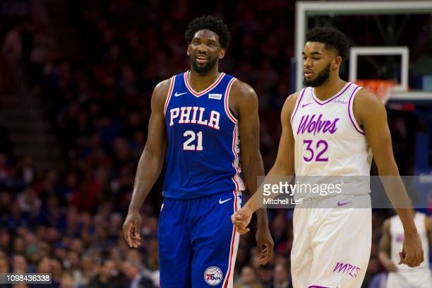 Joel Embiid of the Philadelphia 76ers and KarlAnthony Towns of the Minnesota Timberwolves look on at the Wells Fargo Center on January 15 2019 in...