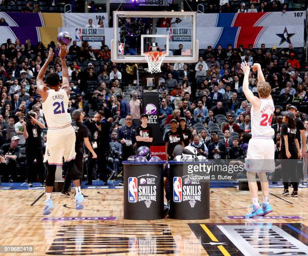 Joel Embiid of the Philadelphia 76ers and Lauri Markkanen of the Chicago Bulls shoots the ball during the Taco Bell Skills Challenge during State...