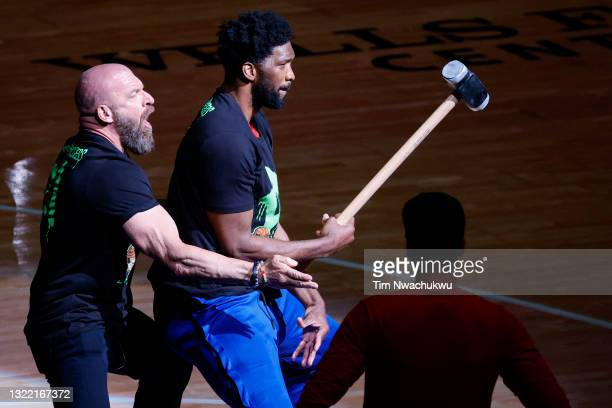 Joel Embiid of the Philadelphia 76ers and Triple H perform before Game One of the Eastern Conference second round series between the Philadelphia...