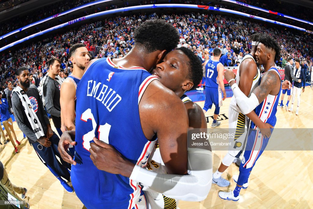 Joel Embiid #21 of the Philadelphia 76ers and Victor Oladipo #4 of the  Indiana