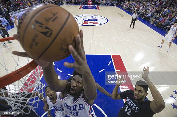 Joel Embiid of the Philadelphia 76ers attempts a shot in front of KarlAnthony Towns of the Minnesota Timberwolves in the first quarter at the Wells...