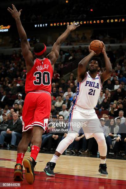 Joel Embiid of the Philadelphia 76ers attempts a shot while being guarded by Noah Vonleh of the Chicago Bulls in the second quarter at the United...