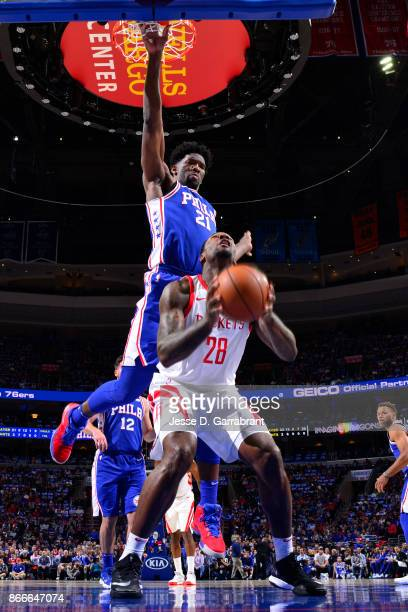 Joel Embiid of the Philadelphia 76ers attempts to block a shot against Tarik Black of the Houston Rockets on October 25 2017 at Wells Fargo Center in...