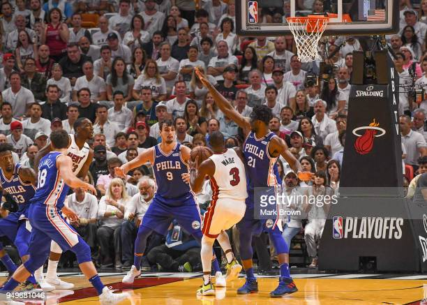 Joel Embiid of the Philadelphia 76ers attempts to block the shot of Dwyane Wade of the Miami Heat in the second quarter during Game Four of Round One...