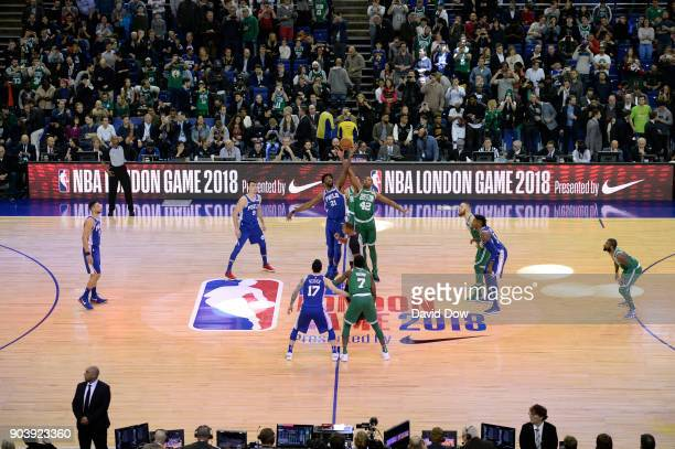 Joel Embiid of the Philadelphia 76ers battles Al Horford of the Boston Celtics for the jump bal during the 2018 NBA London Game at the 02 Arena on...