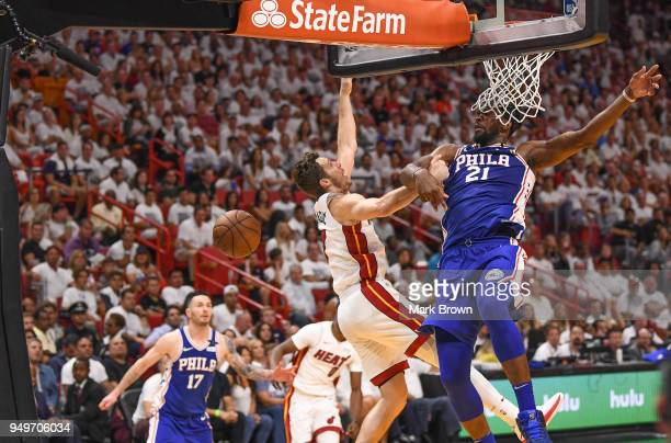 Joel Embiid of the Philadelphia 76ers blocks a shot by Goran Dragic of the Miami Heat in the fourth quarter during Game Four of Round One of the 2018...
