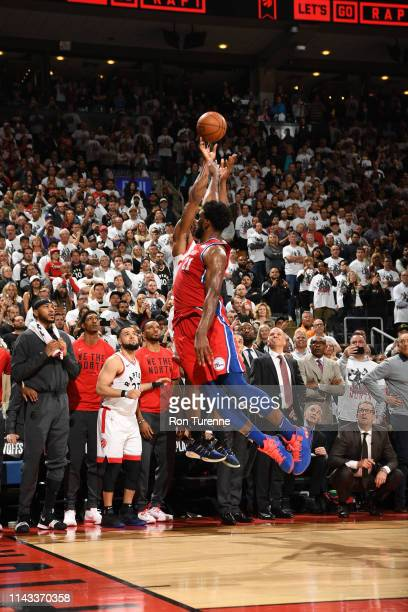 Joel Embiid of the Philadelphia 76ers blocks as Kawhi Leonard of the Toronto Raptors shoots the game-winning three-point basket in Game Seven of the...