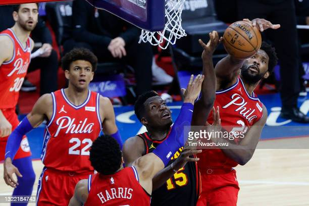Joel Embiid of the Philadelphia 76ers blocks Clint Capela of the Atlanta Hawks during the third quarter during Game One of the Eastern Conference...