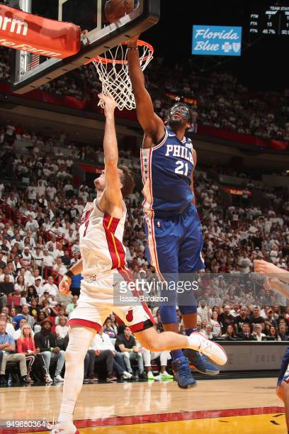 Joel Embiid of the Philadelphia 76ers blocks the shot by Goran Dragic of the Miami Heat in Game Four of the Eastern Conference Quarterfinals during...
