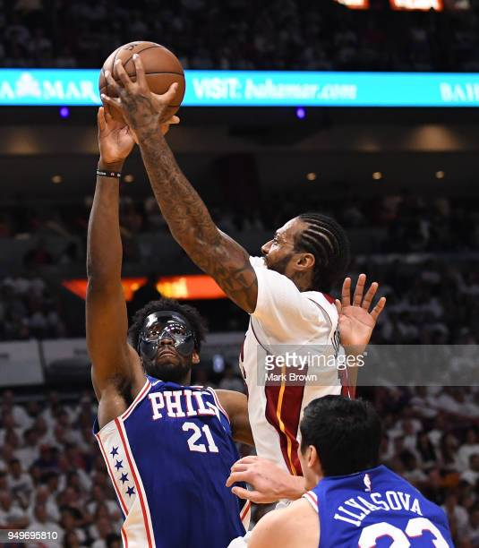 Joel Embiid of the Philadelphia 76ers blocks the shot of James Johnson of the Miami Heat in the third quarter during Game Four of Round One of the...