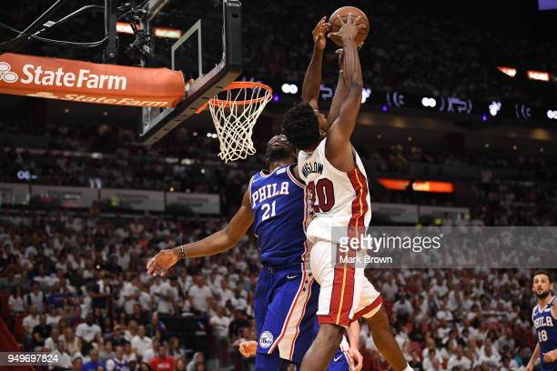 Joel Embiid of the Philadelphia 76ers blocks the shot of Justise Winslow of the Miami Heat in the third quarter during Game Four of Round One of the...