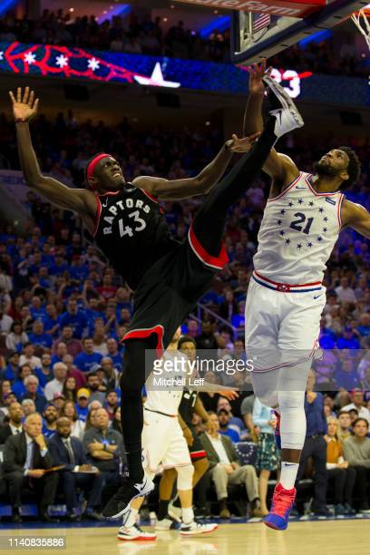 Joel Embiid of the Philadelphia 76ers blocks the shot of Pascal Siakam of the Toronto Raptors in the fourth quarter of Game Three of the Eastern...