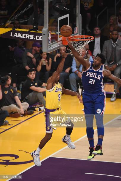 Joel Embiid of the Philadelphia 76ers blocks the shot of Rajon Rondo of the Los Angeles Lakers on January 29 2019 at STAPLES Center in Los Angeles...