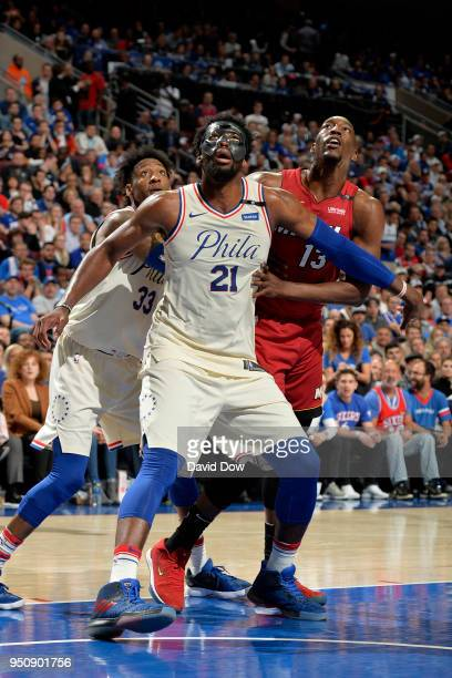 Joel Embiid of the Philadelphia 76ers boxes out against the Miami Heat in Game Five of Round One of the 2018 NBA Playoffs on April 24 2018 at the...