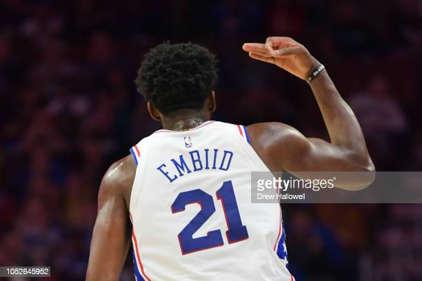 Joel Embiid of the Philadelphia 76ers celebrates a three point shot against the Orlando Magic at Wells Fargo Center on October 20 2018 in...