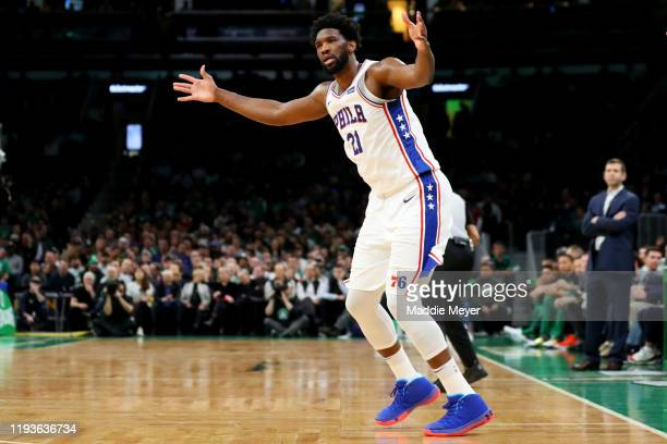Joel Embiid of the Philadelphia 76ers celebrates in the fourth quarter after scoring against the Boston Celtics at TD Garden on December 12 2019 in...