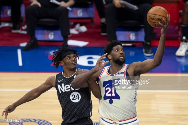 Joel Embiid of the Philadelphia 76ers controls the ball against Alize Johnson of the Brooklyn Nets in the fourth quarter at the Wells Fargo Center on...