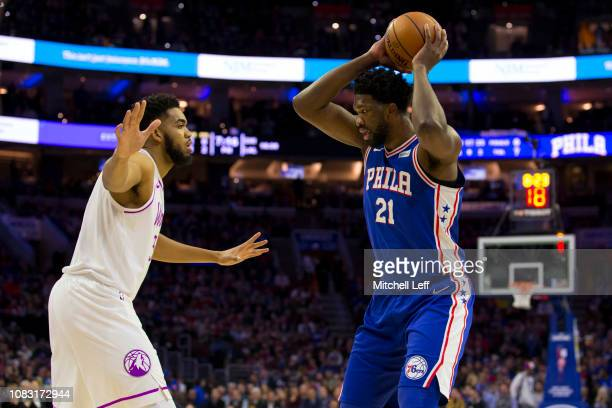 Joel Embiid of the Philadelphia 76ers controls the ball against KarlAnthony Towns of the Minnesota Timberwolves in the first quarter at the Wells...