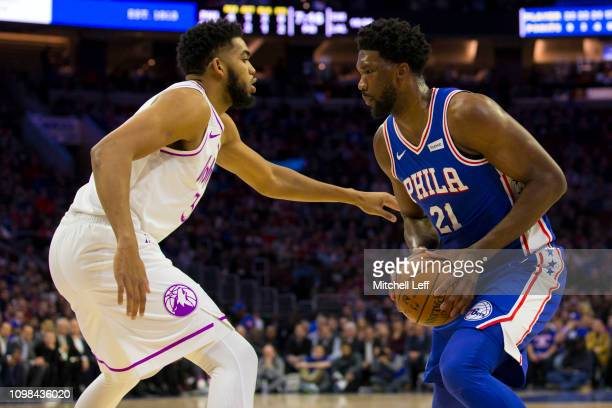 Joel Embiid of the Philadelphia 76ers controls the ball against KarlAnthony Towns of the Minnesota Timberwolves at the Wells Fargo Center on January...