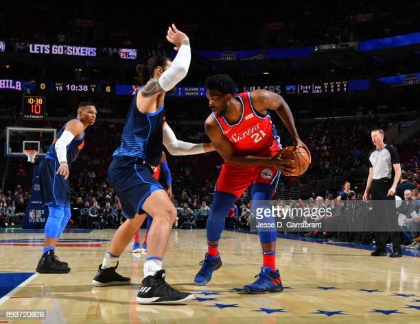 Joel Embiid of the Philadelphia 76ers controls the ball against the Oklahoma City Thunder at Wells Fargo Center on December 15 2017 in Philadelphia...