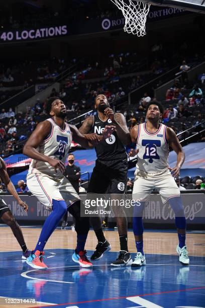 Joel Embiid of the Philadelphia 76ers, DeAndre Jordan of the Brooklyn Nets, and Tobias Harris of the Philadelphia 76ers look to rebound on April 14,...
