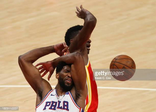 Joel Embiid of the Philadelphia 76ers draws a foul from Clint Capela of the Atlanta Hawks during the second half of game 3 of the Eastern Conference...