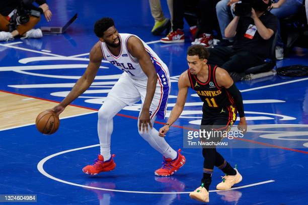Joel Embiid of the Philadelphia 76ers dribbles past Trae Young of the Atlanta Hawks during the first quarter during Game Seven of the Eastern...