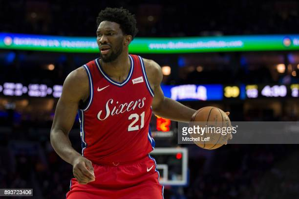 Joel Embiid of the Philadelphia 76ers dribbles the ball against the Oklahoma City Thunder in the second quarter at the Wells Fargo Center on December...