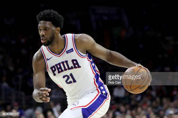 Joel Embiid of the Philadelphia 76ers dribbles the ball against the Milwaukee Bucks in the first half at Wells Fargo Center on January 20 2018 in...