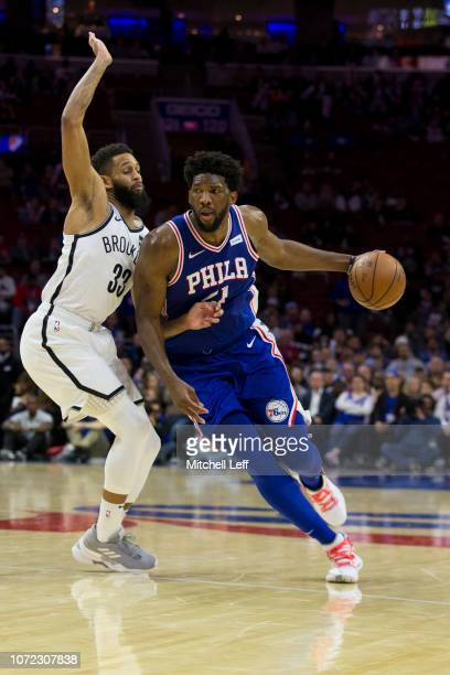 Joel Embiid of the Philadelphia 76ers drives to the basket against Allen Crabbe of the Brooklyn Nets in the fourth quarter at the Wells Fargo Center...
