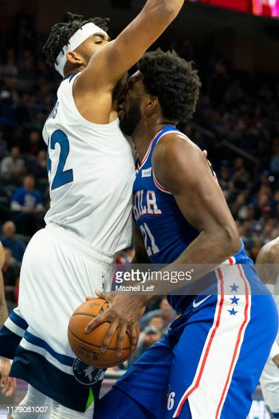 Joel Embiid of the Philadelphia 76ers drives to the basket against KarlAnthony Towns of the Minnesota Timberwolves in the first quarter at the Wells...