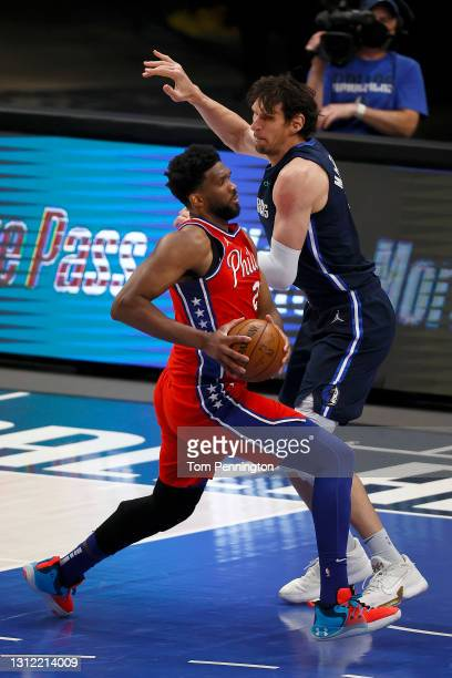 Joel Embiid of the Philadelphia 76ers drives to the basket against Boban Marjanovic of the Dallas Mavericks in the first half at American Airlines...
