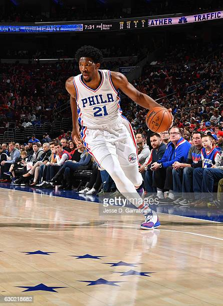 Joel Embiid of the Philadelphia 76ers drives to the basket against the Brooklyn Nets at Wells Fargo Center on December 18 2016 in Philadelphia...