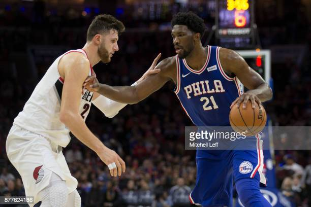 Joel Embiid of the Philadelphia 76ers drives to the basket against Jusuf Nurkic of the Portland Trail Blazers in the fourth quarter at the Wells...
