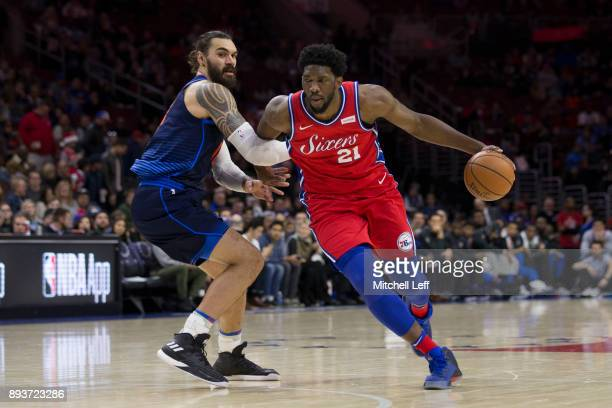 Joel Embiid of the Philadelphia 76ers drives to the basket against Steven Adams of the Oklahoma City Thunder in the first quarter at the Wells Fargo...