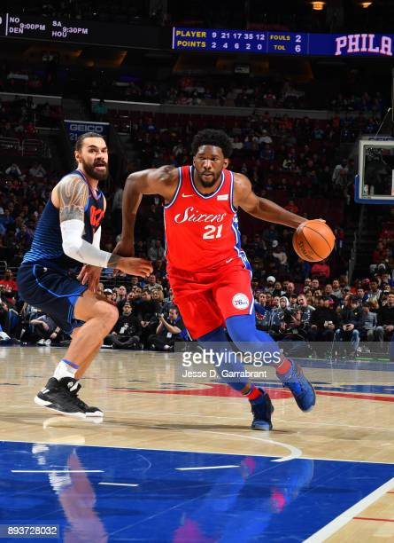 Joel Embiid of the Philadelphia 76ers drives to the basket against the Oklahoma City Thunder at Wells Fargo Center on December 15 2017 in...