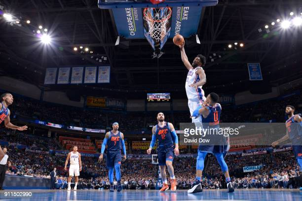 Joel Embiid of the Philadelphia 76ers drives to the basket against the Portland Trail Blazers on January 28 2018 at Chesapeake Energy Arena in...